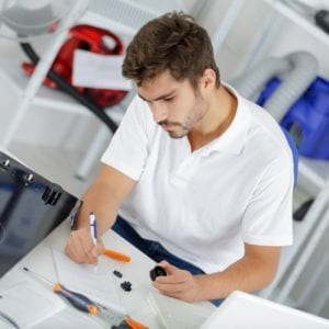 attractive technician calculating quote at clients home